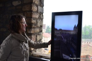 Marina Billoud, my Cluny guide, looks at the augmented reality screen