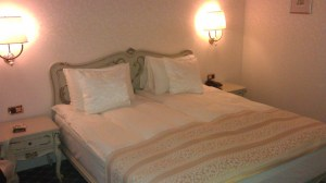 My bed at the Grand Continental Hotel Bucharest