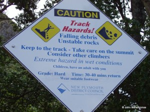 SIgn at the start of the climb of Paritutu rock in New Plymouth., New Zealand