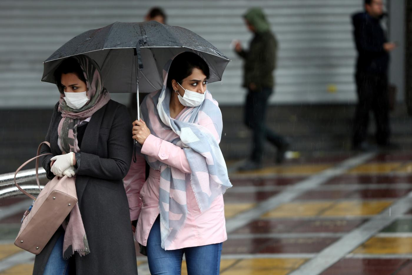 iranian women wear protective masks to prevent contracting coronavirus as they walk in the street in tehran reuters 25 feb 2020
