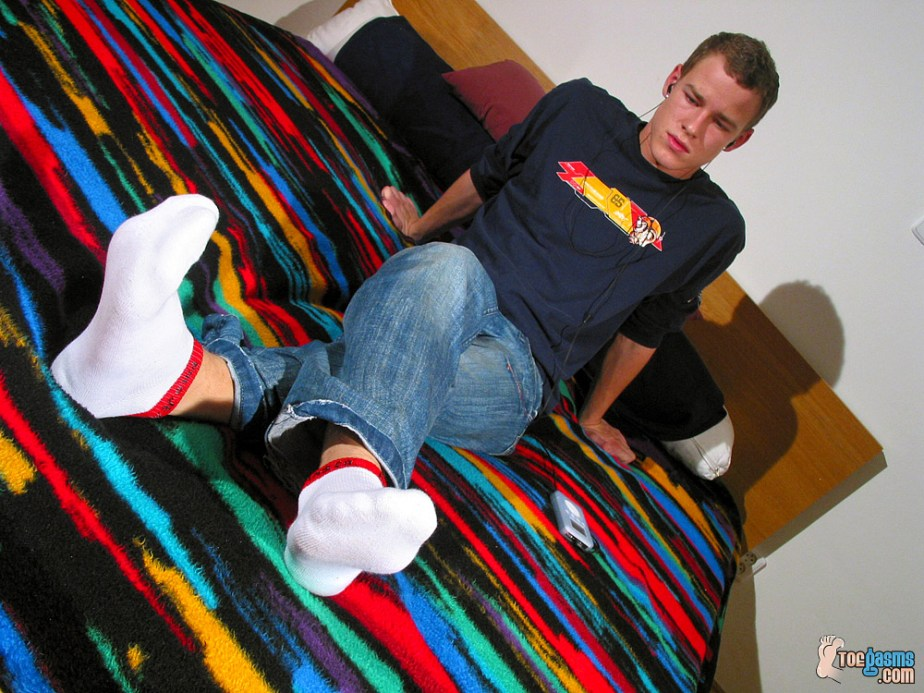 Lukas Cash puts his white socked feet up while listening to music for Toegasms - male feet porn