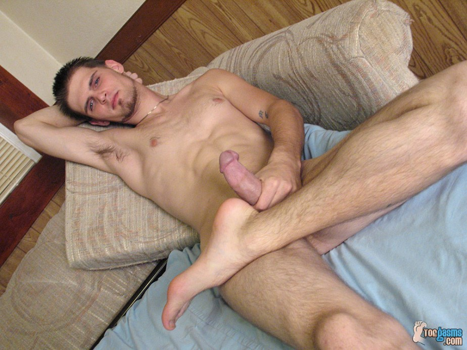 Nolan strokes his cock with his foot up for Toegasms