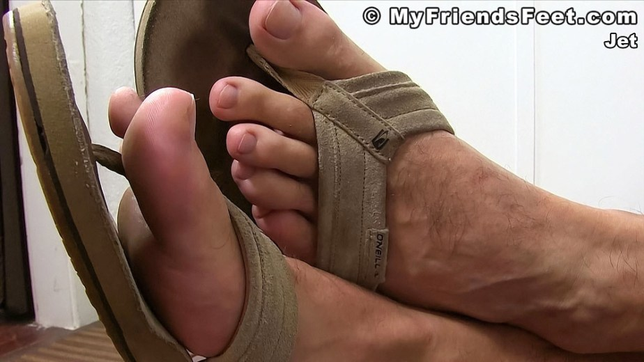 Jet shows off his size 12 feet in O'Neill flip flops - My Friends' Feet - gay foot porn