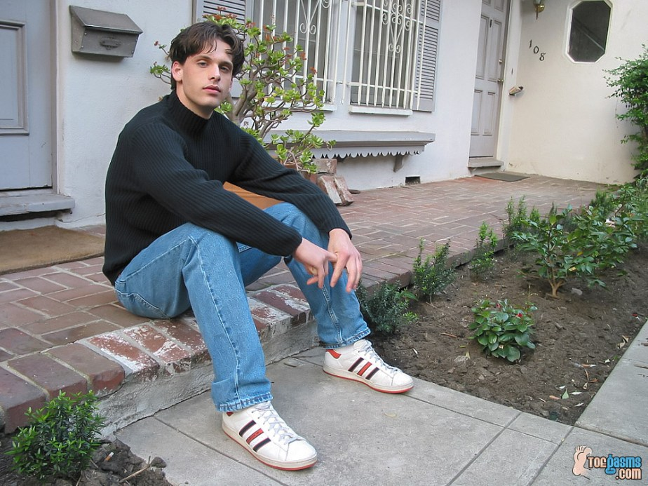 Jared in his Adidas sneakers in the yard for Toegasms