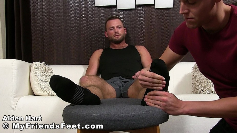 Nathan massages Aiden Hart's black socks for My Friends Feet