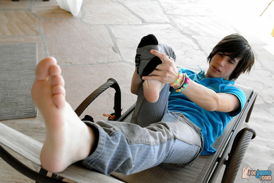 Brendan shows off his bare sole while he peels off his Fallen sock for Toegasms