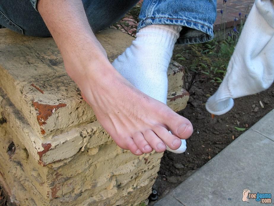 Jared peels off his white crew sock exposing his bare foot for Toegasms