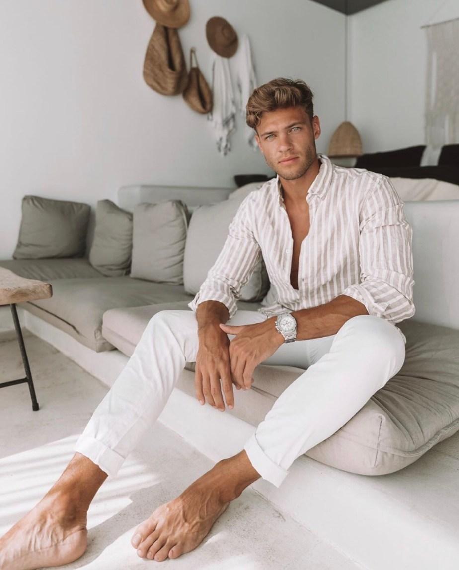Tobias Reuter barefoot on the sofa