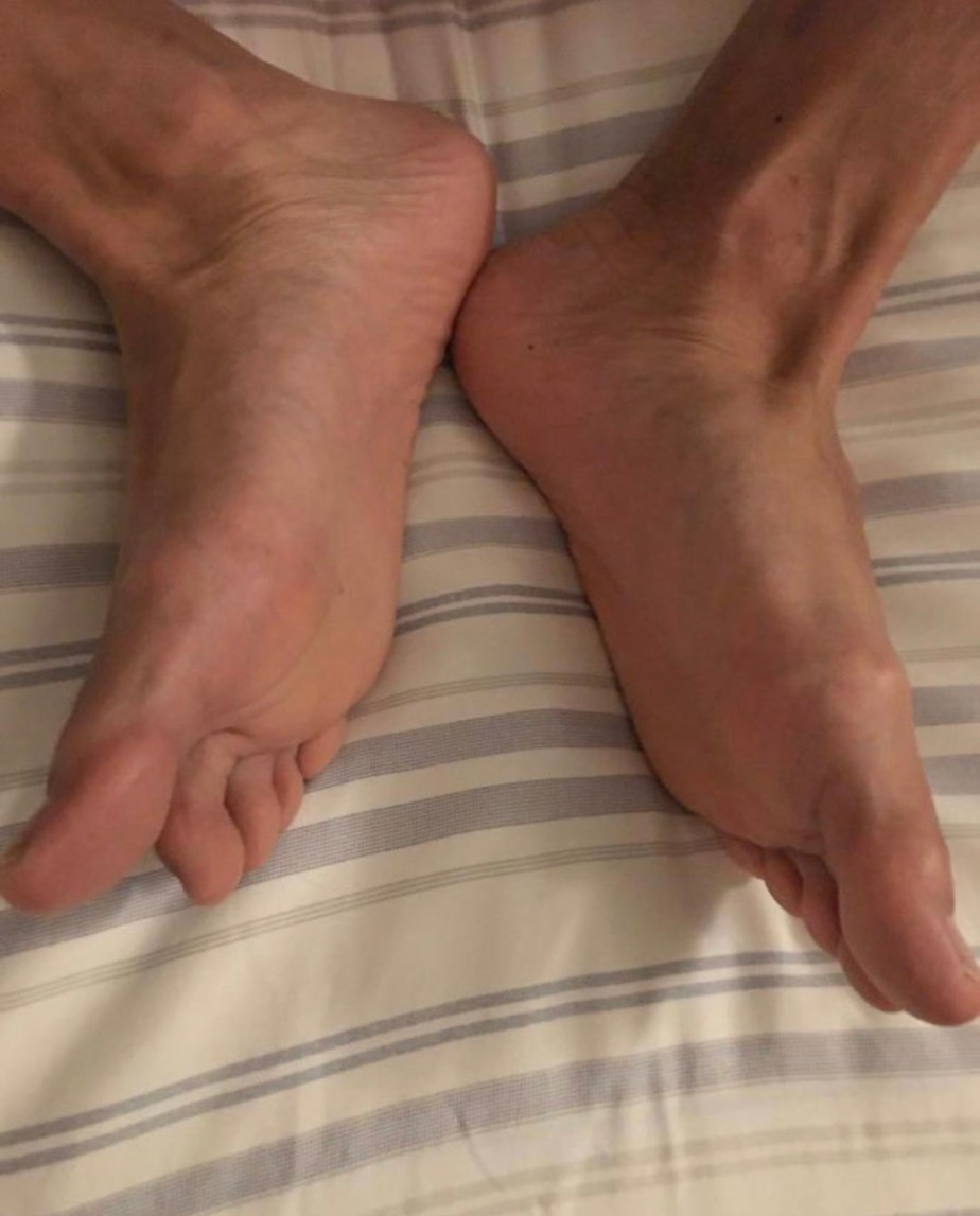 Bayareafootguy's size 12 feet in bed