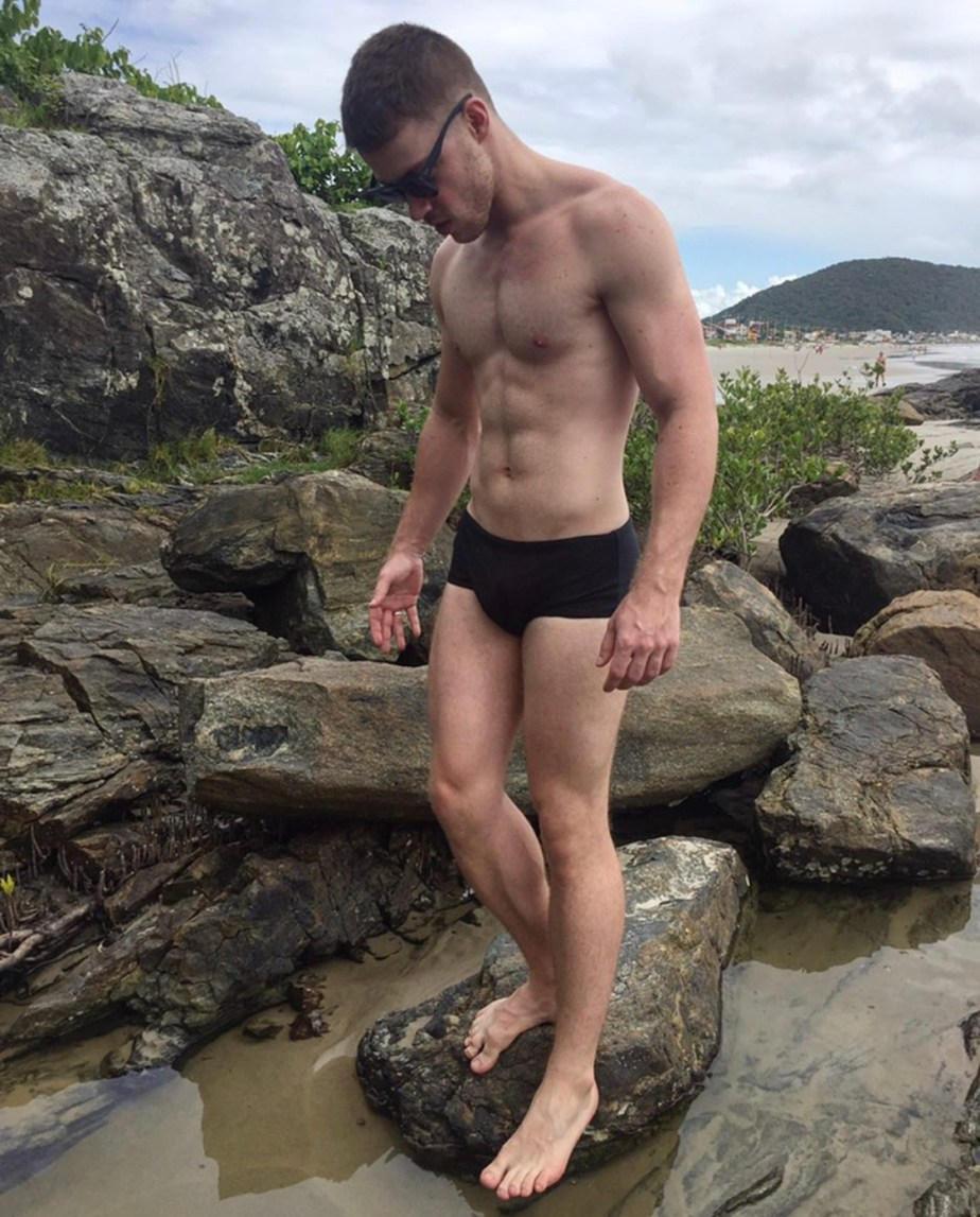 maarcelosouza shirtless and barefoot at the beach