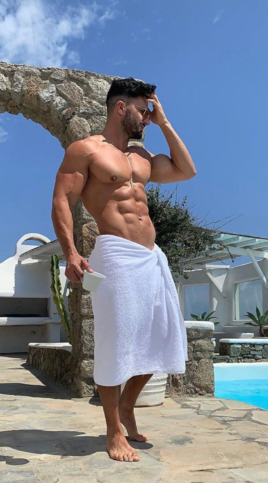 _plus01 in a towel bearded, shirtless and barefoot