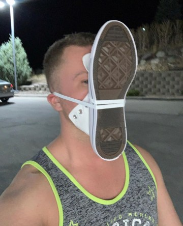 Slcsneakerlicker sniffing his Converse sneaker