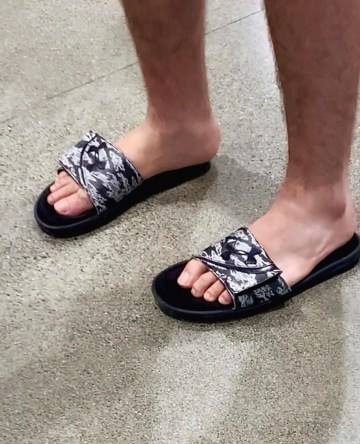 Barefoot in Under Armour slides by bro.toes