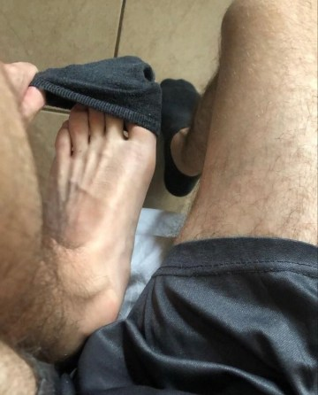 feetcrguy shows off his size 9 feet out of black ankle socks