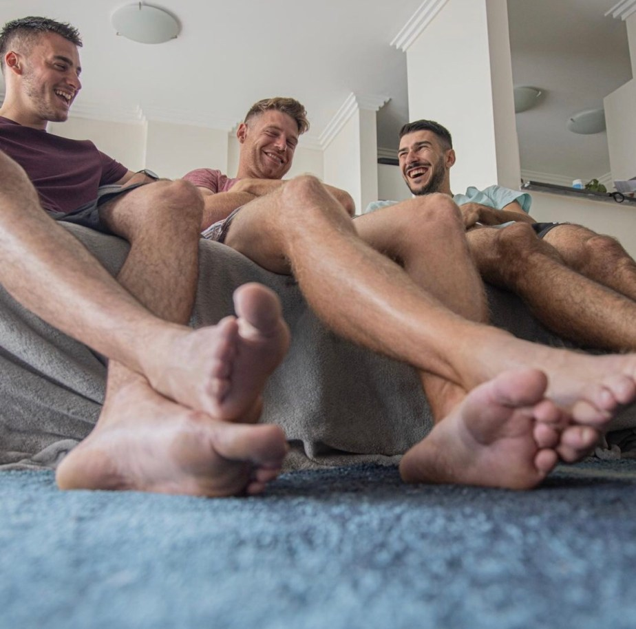 The trio show off their bare legs and feet for giant_and_tiny