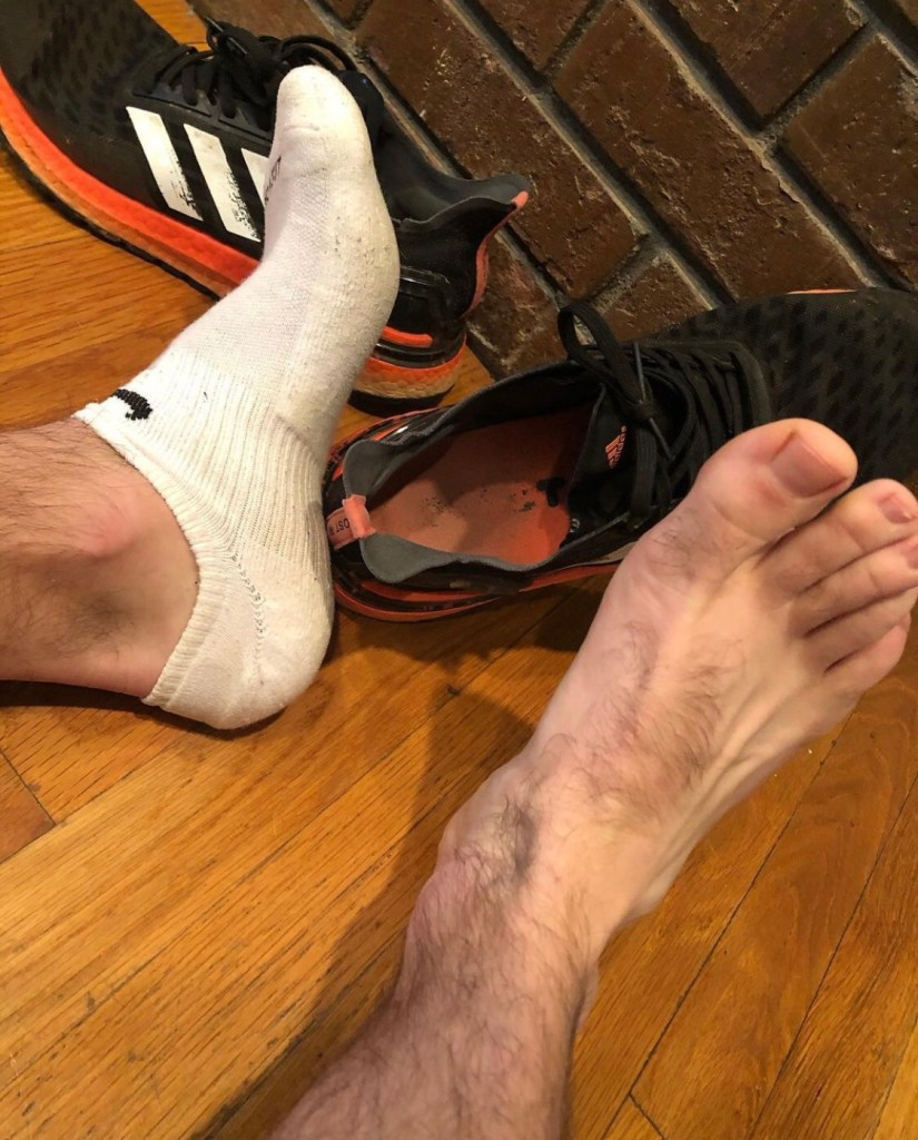 Jakesamazingfeet's bare foot out of white Nike ankle socks and Adidas sneakers