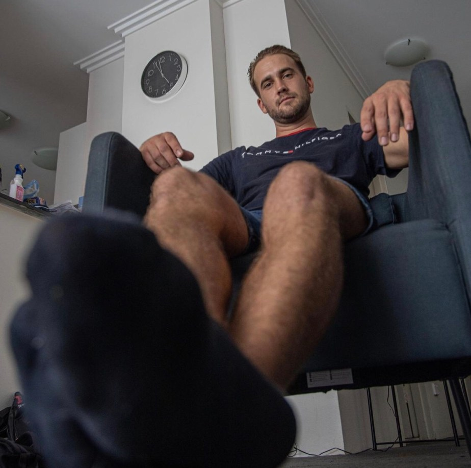Bearded Jack shows off his black socked feet for giant_and_tiny