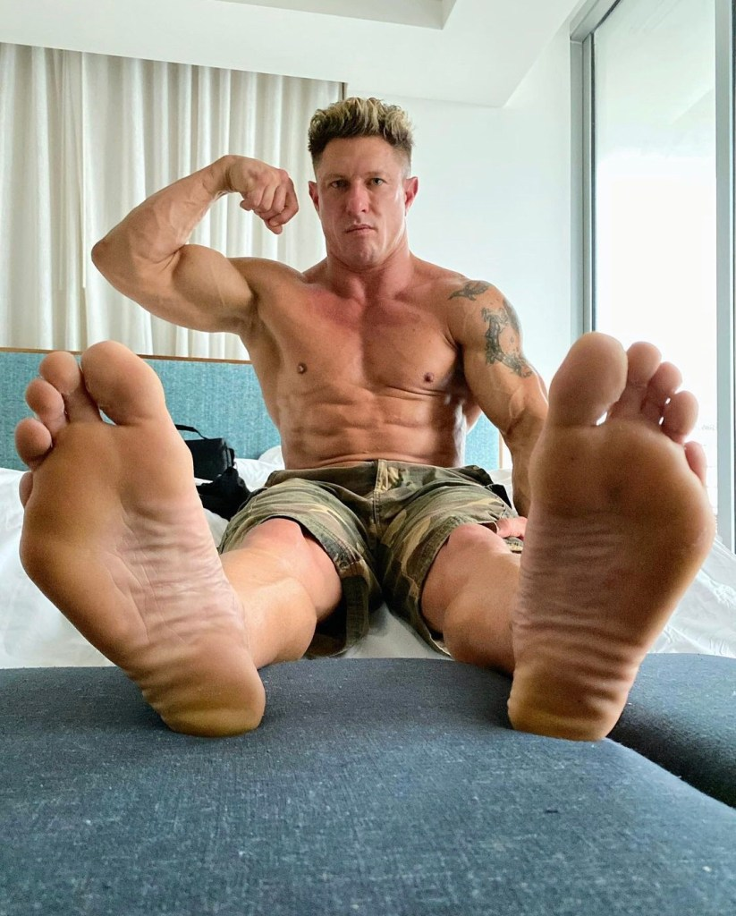 Shirtless Bryce Evans shows off his bare soles and muscles for officialcaseycooper