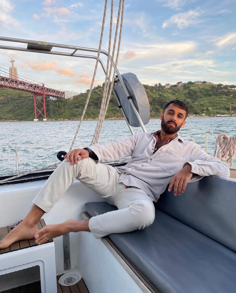 murad_merali bearded and barefoot on a boat