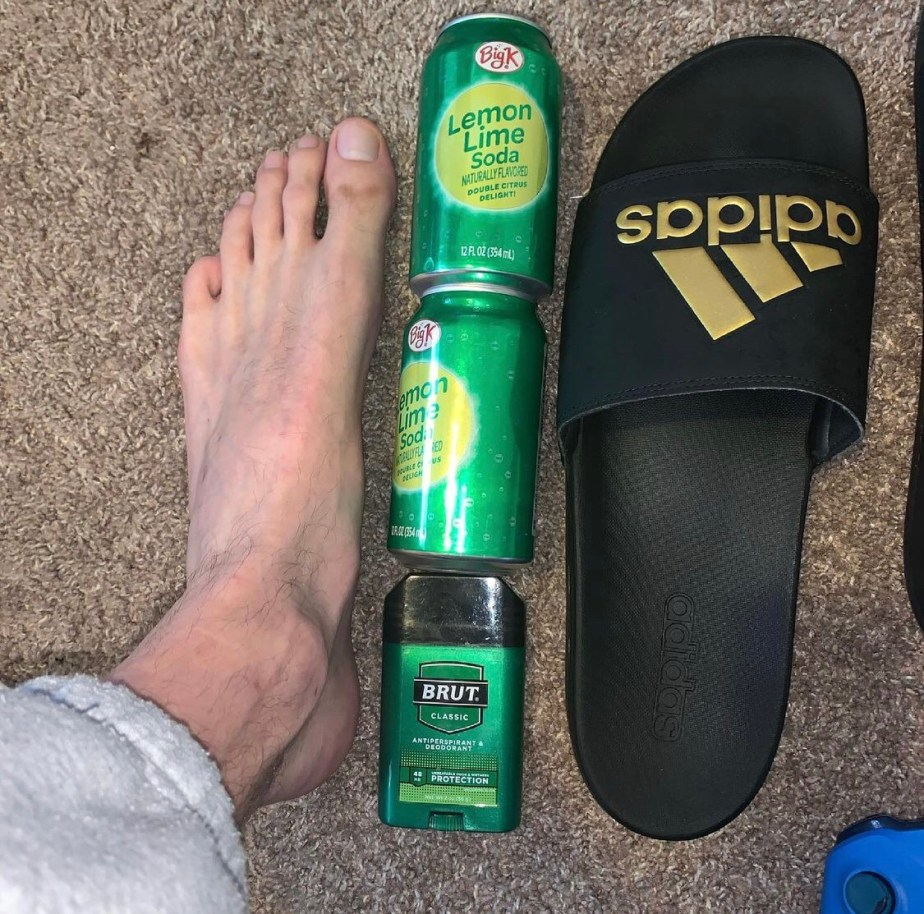 7footageofficial compares his size 18 foot and Adidas slide