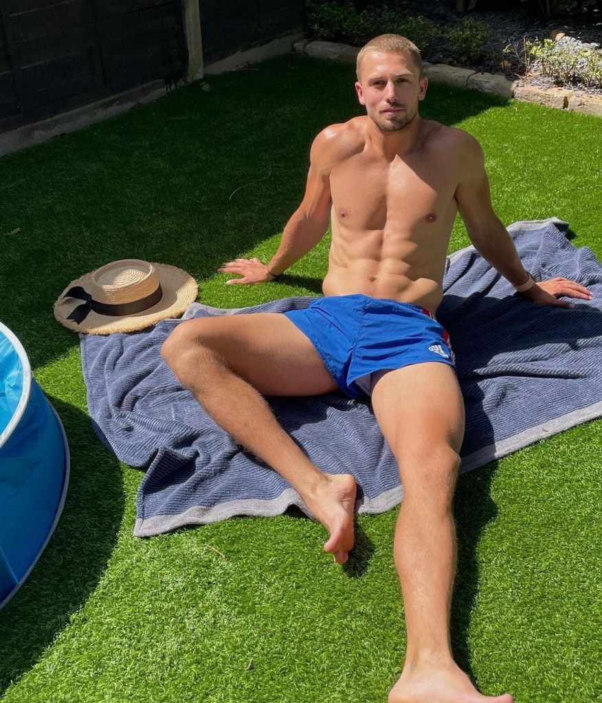 yatesy17 shirtless and barefoot outside on the grass