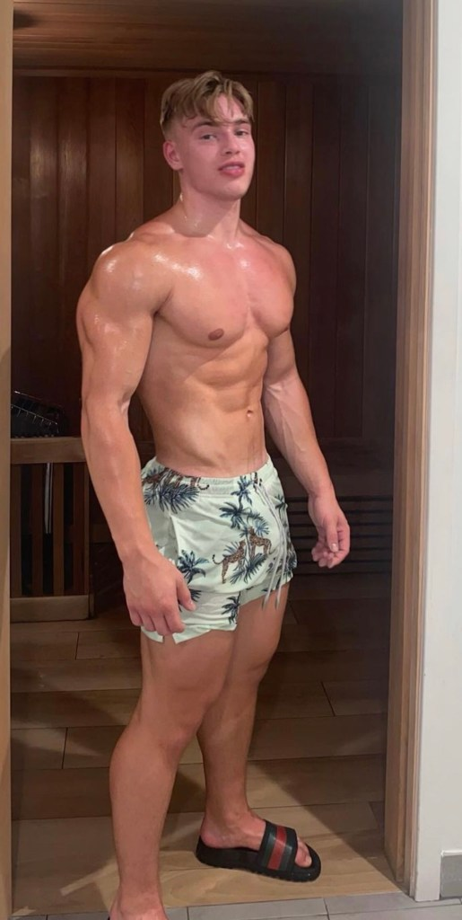 oliverforslin shirtless and barefoot in slides by the sauna