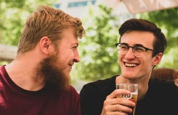 Two men smiling together