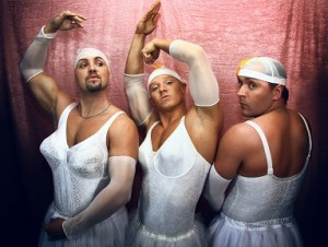 Three men in ballerina suits