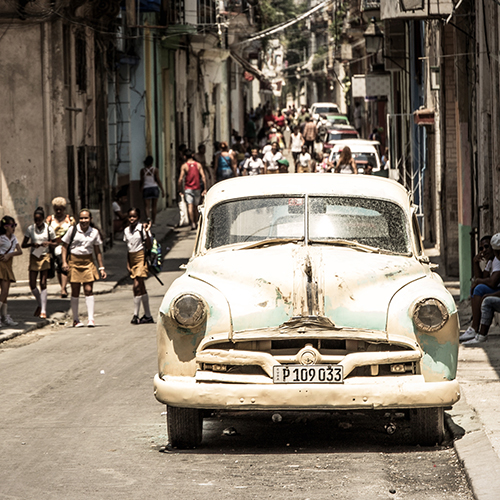 old car in a crowdy street