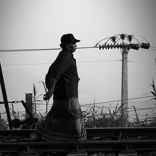 Man walking on the rail road