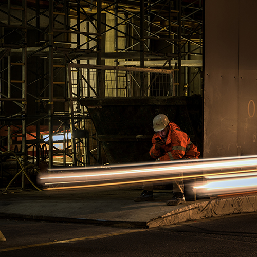Road worker at night
