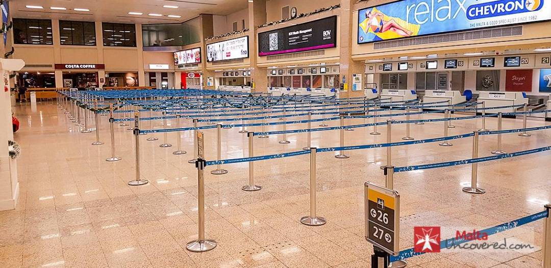 The check-in area of the departures terminal at Malta's airport.