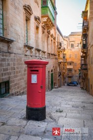 A small street in Valletta with an obvious trace of British history.