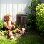 Garden guardian made from old clay pots