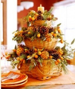 Flowers and candles in baskets thanksgiving centrepiece