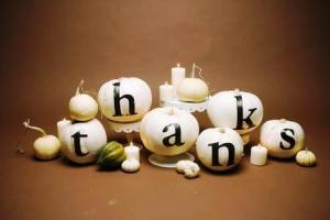 thanks written on white pumpkins centrepiece