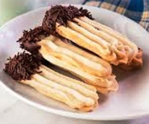 Make fingers using cookies press - or roll out the dough and press with a fork to create the pattern. Let cookies cool down and dip one end in melted chocolate.
