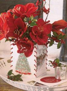 Use old Christmas cards to create an inexpensive and very effective holder - stitch side together with a thin red ribbon or knitting wool, use florist foam inside and insert blooms you have grown! Great gift or your own dinner table centerpiece.