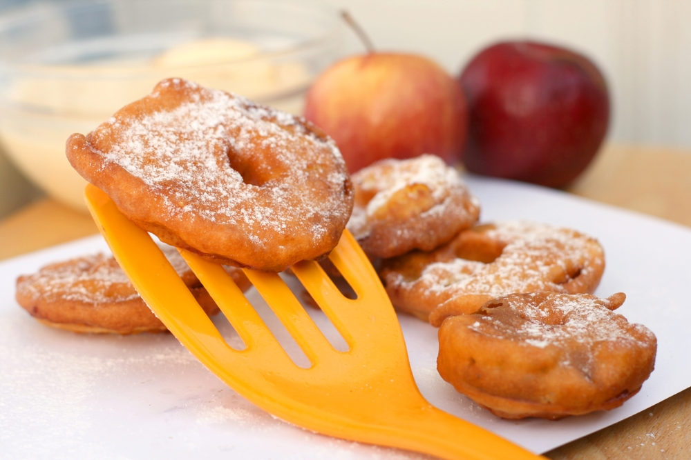apple fritter on an organge spatula