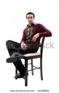 stock-photo-handsome-guy-wearing-business-casual-clothes-sitting-on-a-high-chair-with-legs-crossed-and-arm-24489694