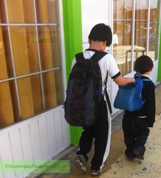 Boys approaching crosswalk on the way to school.