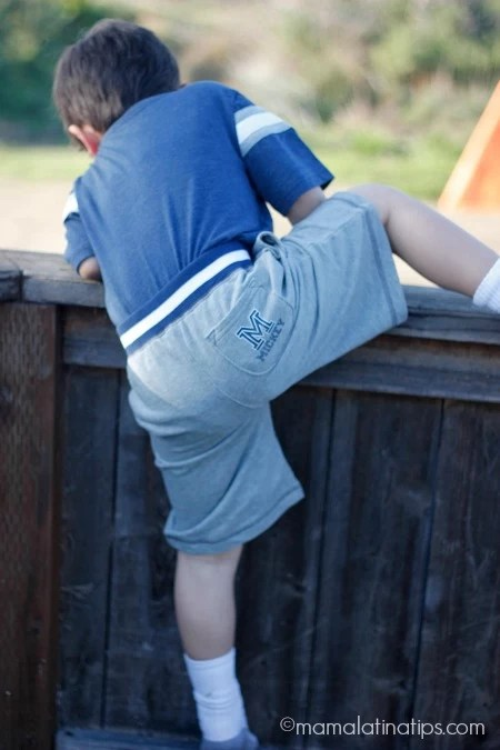 kid jumping over fence - mamalatinatips.com