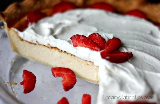 Mexican cheesecake with whipped cream and strawberries