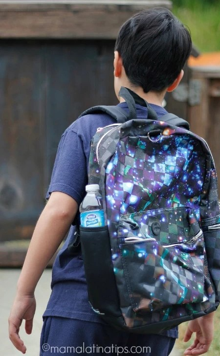 kid walking with a backpack