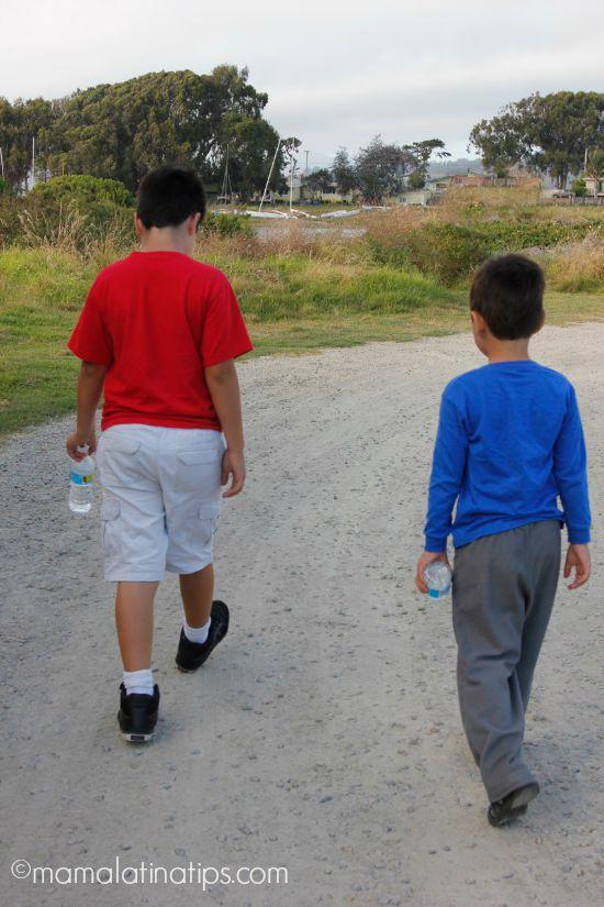 kids walking with water bottles