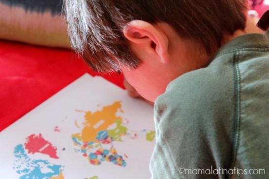 Kid looking at map - mamalatinatips.com