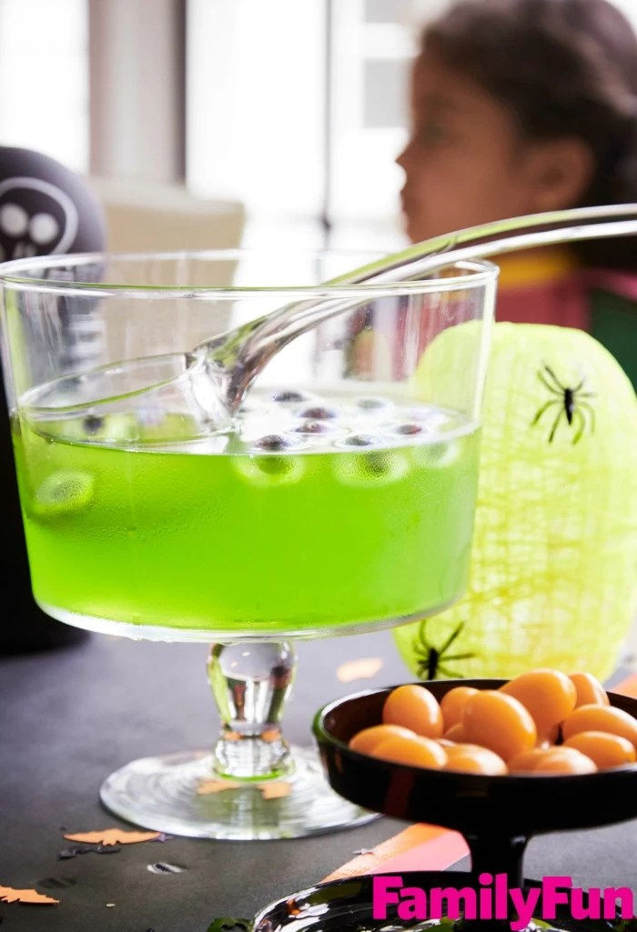 Green punch for Halloween with blueberry eyes