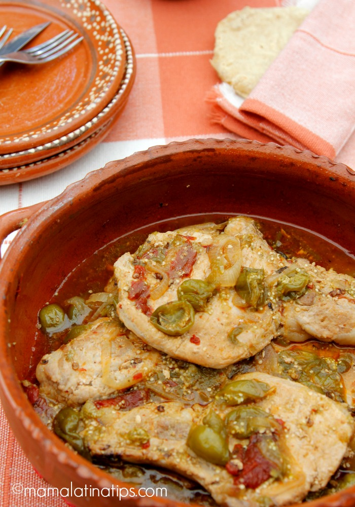 Pork chops with tomatillos and chipotles in a clay cazuela