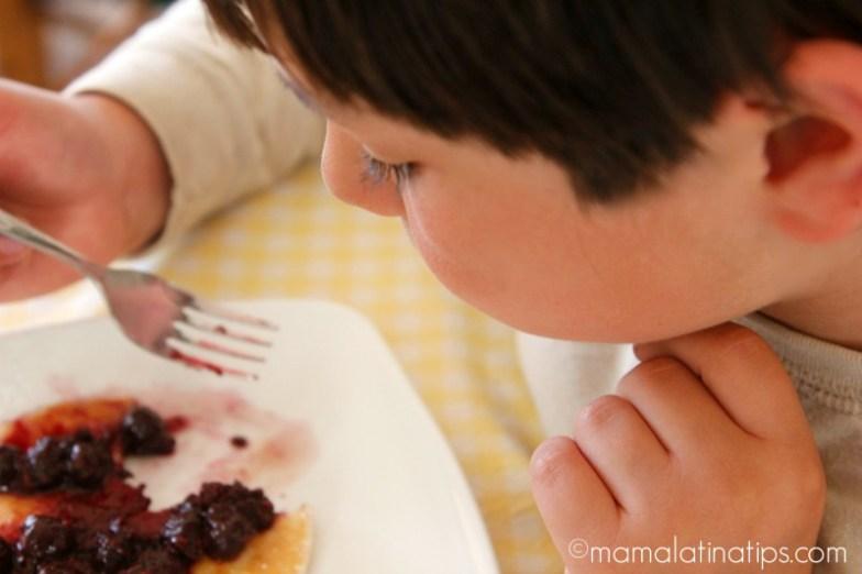 Child eating Lemon Pancakes