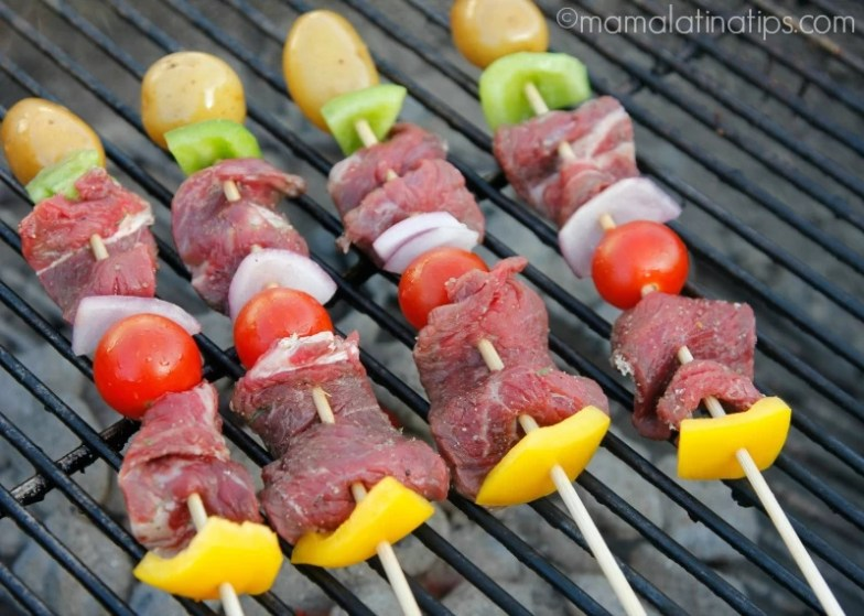Angus Beef Kabobs with cherry tomatoes, peppers and potatoes on the grill